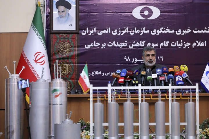 In this photo released by the Atomic Energy Organization of Iran, spokesman of the organization Behrouz Kamalvandi speaks in a news briefing as advanced centrifuges are displayed in front of him, in Tehran, Iran, Saturday, Sept. 7, 2019. Iran has begun injecting uranium gas into advanced centrifuges in violation of its 2015 nuclear deal with world powers, Kamalvandi said. (Atomic Energy Organization of Iran via AP)