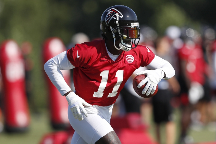 FILE - In this July 25, 2019, file photo, Atlanta Falcons wide receiver Julio Jones (11) runs after a catch during their NFL training camp football practice in Flowery Branch, Ga. For Julio Jones, it's just business as usual _ even as he closes in on a huge new contract with the Atlanta Falcons. (AP Photo/John Bazemore, File)