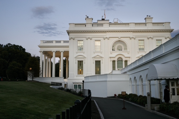 A man enters the press area of the White House at dusk, Saturday, Sept. 7, 2019, in Washington. On Saturday, Sept. 7, 2019, President Donald Trump tweeted he has called off a secret Camp David meeting with Taliban and Afghanistan leaders. (AP Photo/Jacquelyn Martin)