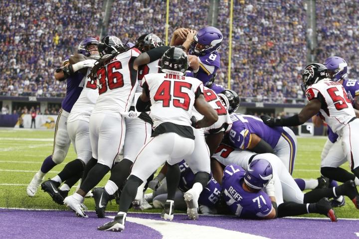 Minnesota Vikings quarterback Kirk Cousins (8) scores on a 1-yard touchdown run during the first half of an NFL football game against the Atlanta Falcons, Sunday, Sept. 8, 2019, in Minneapolis. (AP Photo/Bruce Kluckhohn)