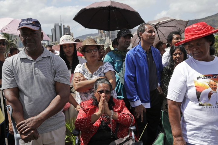 Faithful attend a Mass celebrated by Pope Francis at the Monument Mary Queen of Peace, in Port Louis, Mauritius, Monday, Sept. 9, 2019. Francis has arrived in the Indian Ocean nation of Mauritius to celebrate its diversity, encourage its ethical development and honor a 19th century French missionary who ministered to freed slaves. (AP Photo/Alessandra Tarantino)
