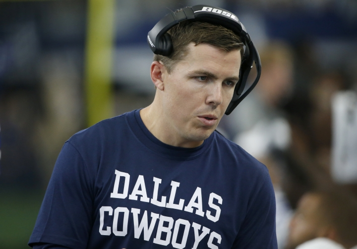 Dallas Cowboys offensive coordinator Kellen Moore talks with players on the sideline in the second half of a NFL football game against the New York Giants in Arlington, Texas, Sunday, Sept. 8, 2019. (AP Photo/Ron Jenkins)