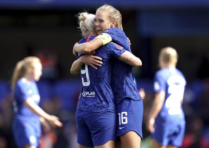 Chelsea's Bethany England, left, celebrates scoring against Tottenham Hotspur with teammate Magdalena Eriksson during the Women's Super League soccer match at Stamford Bridge, London, Sunday Sept. 8, 2019. (John Walton/PA via AP)