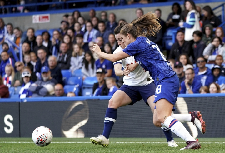 Chelsea's Maren Mjelde, right, and Tottenham Hotspur's Lucy Quinn battle for the ball during the Women's Super League soccer match at Stamford Bridge, London, Sunday Sept. 8, 2019. (John Walton/PA via AP)