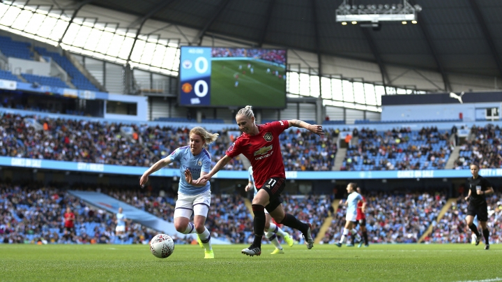 Manchester City's Aoife Mannion, left, and Manchester United's Leah Galton battle for the ball during the Women's Super League soccer match at the Etihad Stadium, Manchester, England, Saturday Sept. 7, 2019. (Nigel French/PA via AP)