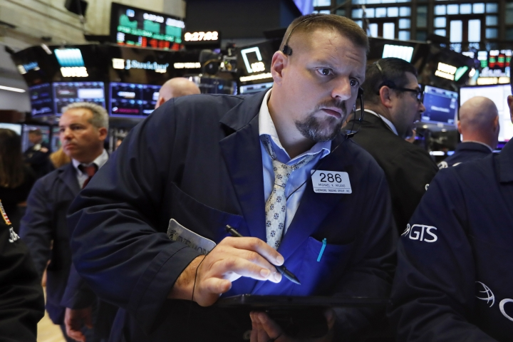 FILE - In this Sept. 4, 2019, file photo trader Michael Milano works on the floor of the New York Stock Exchange. The U.S. stock market opens at 9:30 a.m. EDT on Monday, Sept. 9. (AP Photo/Richard Drew, File)