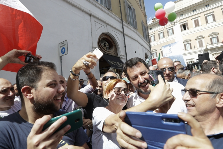 The League's leader Matteo Salvini is surrounded by supporters trying to get selfies with him during a demonstration with far-right party Brothers of Italy against the 5-Star and Democratic party coalition government, in Rome, Monday, Sept. 9, 2019. Italian Premier Giuseppe Conte is pitching for support in Parliament for his new left-leaning coalition ahead of crucial confidence votes. (AP Photo/Andrew Medichini)