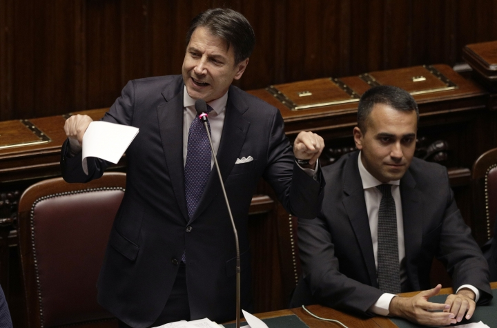 Italian Premier Giuseppe Conte, flanked by Foreign Minister Luigi Di Maio, intervenes in the parliament debate ahead of confidence vote later at the Lower Chamber in Rome, Monday, Sept. 9, 2019. Conte is pitching for support in Parliament for his new left-leaning coalition ahead of crucial confidence votes. (AP Photo/Gregorio Borgia)