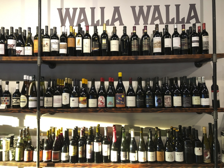 This Aug. 12, 2019 photo shows a selection of local wines at The Thief wine bar and bottle shop in Walla Walla, Wash. Southeastern Washington has been producing high-quality wines for decades. But in the past five years, the wineries of the Walla Walla Valley have drawn international accolades for the reds produced from the unique soil just across the border in Oregon. (AP Photo/Sally Carpenter Hale)