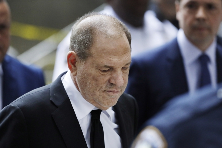 In this Aug. 26, 2019, photo, Harvey Weinstein arrives in court in New York. A new book by The New York Times reporters who uncovered sexual misconduct accusations against Weinstein includes new details on the movie mogul's attempts to stop the newspaper from publishing the story. (AP Photo/Mark Lennihan)
