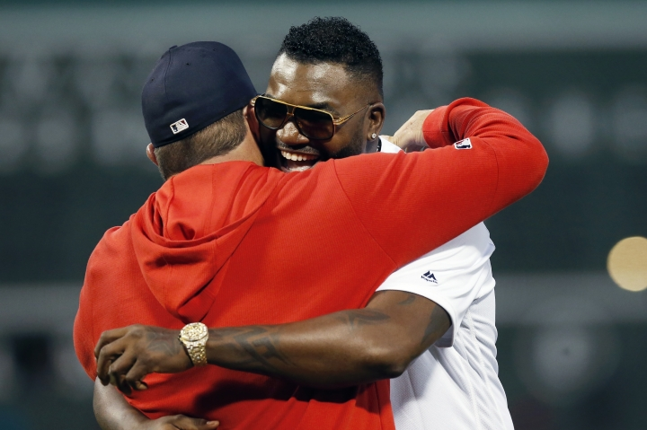 Former Boston Red Sox's David Ortiz, right, hugs former teammate Jason Varitek after throwing out a ceremonial first pitch before a baseball game against the New York Yankees in Boston, Monday, Sept. 9, 2019. (AP Photo/Michael Dwyer)