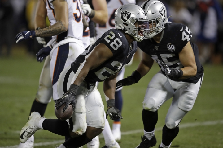 Oakland Raiders running back Josh Jacobs (28) celebrates after scoring a touchdown during the fourth quarter of an NFL football game against the Denver Broncos Monday, Sept. 9, 2019, in Oakland, Calif. At right is running back Alec Ingold (45). (AP Photo/Ben Margot)
