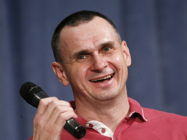 Ukrainian filmmaker Oleg Sentsov, former Russian prisoner, smiles during his press conference in Kyiv, Ukraine, Tuesday, Sept. 10, 2019. After five years of being locked up in a Russian prison Sentsov was one of the 35 freed Ukrainian prisoners. (AP Photo/Efrem Lukatsky)