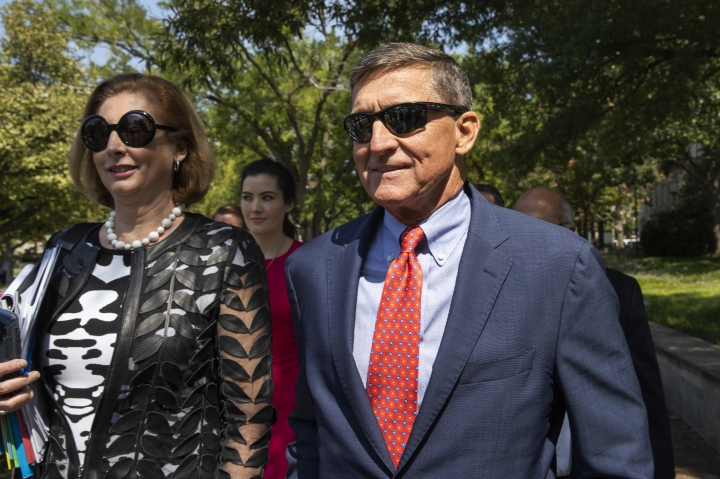 Michael Flynn, President Donald Trump's former national security adviser, leaves the federal court with his lawyer Sidney Powell, left, following a status conference with Judge Emmet Sullivan, in Washington, Tuesday, Sept. 10, 2019. (AP Photo/Manuel Balce Ceneta)