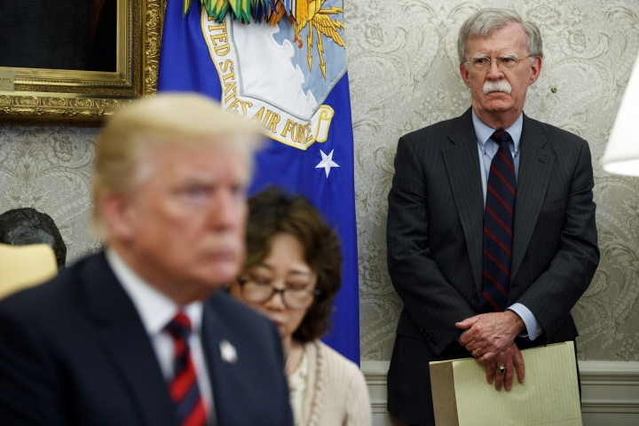 In this May 22, 2018, file photo, U.S. President Donald Trump, left, meets with South Korean President Moon Jae-In in the Oval Office of the White House in Washington, as national security adviser John Bolton, right, watches. Trump says he fired national security adviser John Bolton, says they 'disagreed strongly' on many issues. (AP Photo/Evan Vucci, File)