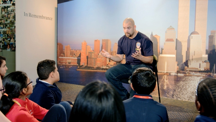 "This image released by HBO shows a New York City Fireman speaking to children in a scene from the documentary ""What Happened on September 11,"" a short film aimed at young people to explain to them what happened on Sept. 11, 2001. The program debuts on Wednesday. (HBO via AP)"