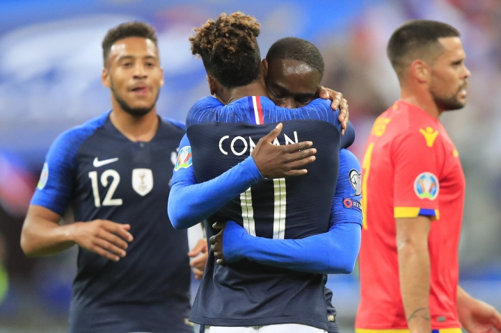 France's Kingsley Coman celebrates his opening goal with France's Jonathan Ikone during the Euro 2020 group H qualifying soccer match between France and Andorra at the Stade de France in Saint Denis, north of Paris, France, Tuesday, Sept. 10, 2019. (AP Photo/Michel Euler)