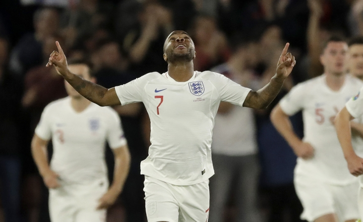 England's Raheem Sterling celebrates scoring his side's first goal during the Euro 2020 group A qualifying soccer match between England and Kosovo at St Mary's Stadium in Southampton, England, Tuesday, Sept. 10, 2019 . (AP Photo/Matt Dunham)