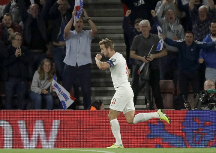 England's Harry Kane celebrates scoring his side's second goal during the Euro 2020 group A qualifying soccer match between England and Kosovo at St Mary's Stadium in Southampton, England, Tuesday, Sept. 10, 2019 . (AP Photo/Matt Dunham)