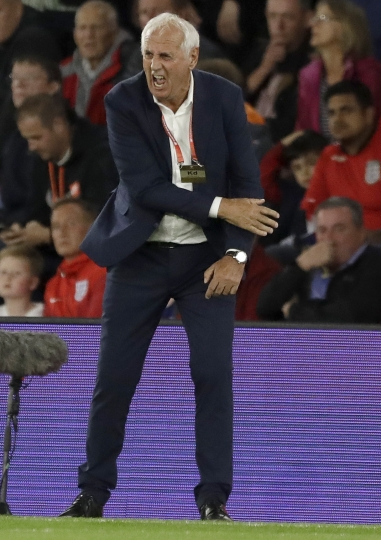Kosovo coach Bernard Challandes reacts after his team scored during the Euro 2020 group A qualifying soccer match between England and Kosovo at St Mary's Stadium in Southampton, England, Tuesday, Sept. 10, 2019 . (AP Photo/Matt Dunham)