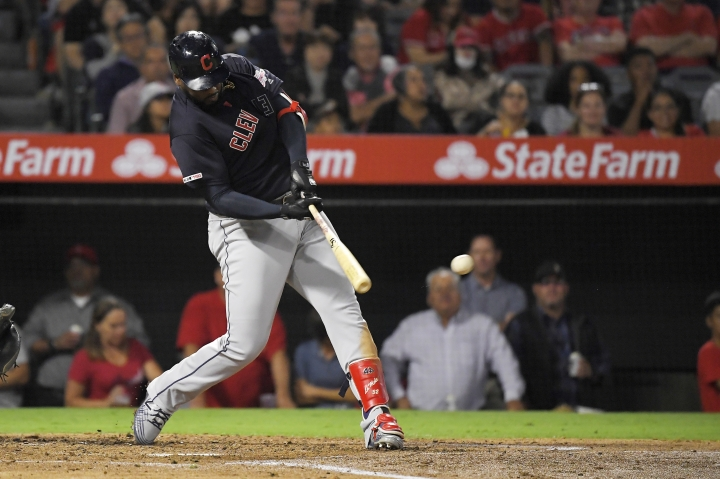 Cleveland Indians' Franmil Reyes hits a three-run double during the third inning of the team's baseball game against the Los Angeles Angels on Tuesday, Sept. 10, 2019, in Anaheim, Calif. (AP Photo/Mark J. Terrill)