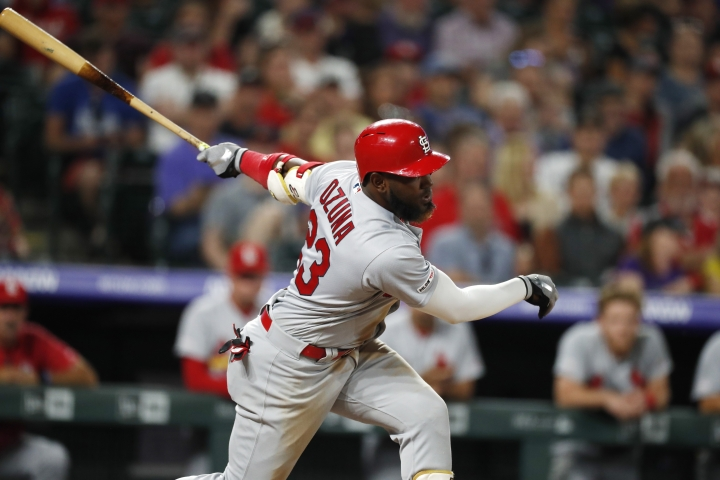 St. Louis Cardinals' Marcell Ozuna strikes out against Colorado Rockies relief pitcher Jairo Diaz to end the top of the eighth inning of a baseball game Tuesday, Sept. 10, 2019, in Denver. Colorado won 2-1. (AP Photo/David Zalubowski)