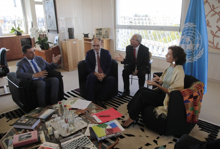 Governor of the province Nineveh Mansour al-Mareed, left, and Iraq's Culture Minister Abdulamir al-Dafar Hamdani, center, meet UNESCO'S Director-General Audrey Azoulay at the UNESCO's headquarters in Paris, Wednesday, Sept. 11. 2019. Iraqi officials meet at the UN's cultural agency in Paris to discuss plans for an ambitious $100 million reconstruction of the Islamic State-ravaged city of Mosul. (AP Photo/Michel Euler)