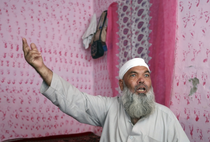 """In this Tuesday, Sept. 10, 2019, photo, Hayat Khan, 54, speaks during an interview with The Associated Press after being wounded in a Taliban car bomb outside a compound housing several foreign organizations and guesthouses, in Kabul, Afghanistan. """"Our only hope was peace,"""" Hayat Khan, the family's 54-year-old patriarch, said, """"and that doesn't happen now."""" (AP Photo/Rahmat Gul)"""