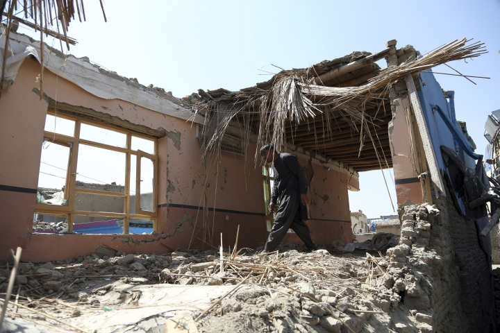 "In this Tuesday, Sept. 10, 2019, photo, Samiullah inspects the remains of his damaged house after a large explosion last week near a compound housing several foreign organizations and guesthouses, in Kabul, Afghanistan. President Donald Trump says U.S.-Taliban talks on ending the war in Afghanistan are ""dead,"" deeply unfortunate wording for the Afghan civilians who have been killed by the tens of thousands over almost 18 years. (AP Photo/Rahmat Gul)"