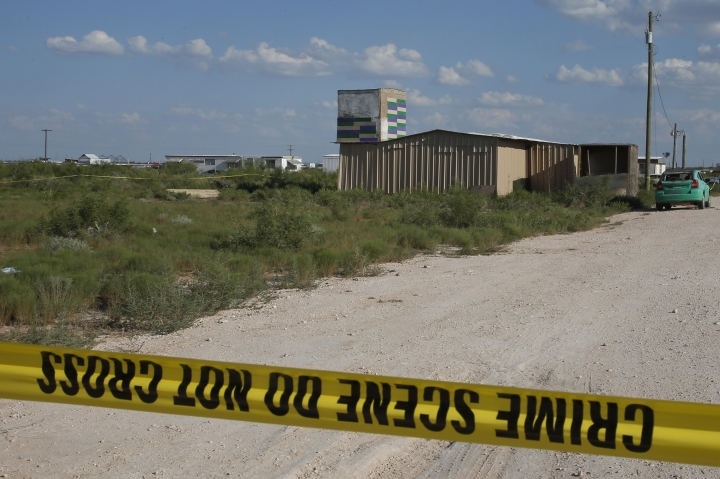 Crime scene tape surrounds the home of Seth Aaron Ator, the alleged gunman in a West Texas rampage Saturday, on Monday, Sept. 2, 2019, near Odessa, Texas. Officers killed 36-year-old Ator on Saturday outside a busy Odessa movie theater after a spate of violence that spanned 10 miles (16 kilometers), killing multiple people and injuring around two dozen others. (AP Photo/Sue Ogrocki)