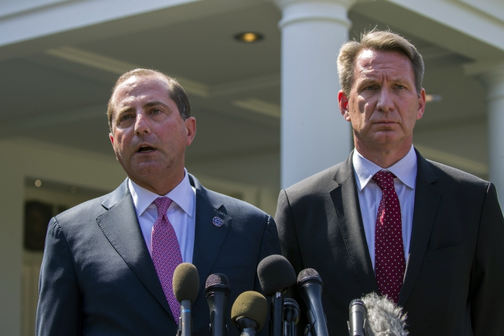 Health and Human Services Secretary Alex Azar, left, and acting FDA Commissioner Ned Sharpless speak with reporters after a meeting about vaping with President Donald Trump in the Oval Office of the White House, Wednesday, Sept. 11, 2019, in Washington. (AP Photo/Alex Brandon)