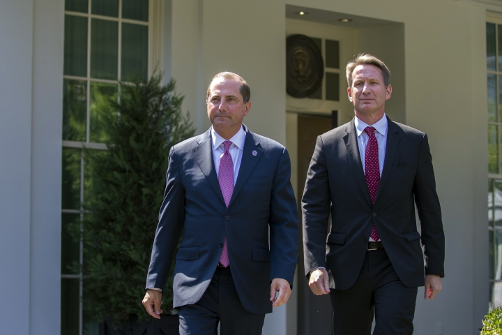 Health and Human Services Secretary Alex Azar, left, and acting FDA Commissioner Ned Sharpless arrive to speak with reporters after a meeting about vaping with President Donald Trump in the Oval Office of the White House, Wednesday, Sept. 11, 2019, in Washington. (AP Photo/Alex Brandon)