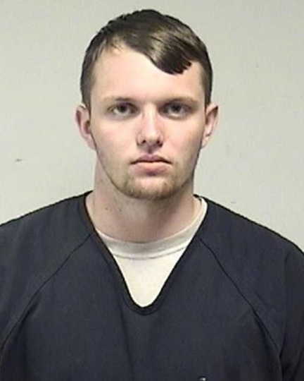 In this photo provided by the Kenosha County Sheriff's Office, Tyler Huffhines is pictured in a booking photo. Huffhines is accused of manufacturing thousands of counterfeit vaping cartridges a day with THC oil for almost two years, running the operation with 10 employees, authorities said. (Kenosha County Sheriff's Office via AP)
