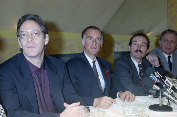 In this April 2, 1992, file photo, actor Raúl Juliá, left, listens during a meeting with Latino journalist in New York with then Democratic presidential hopeful Jerry Brown, center. Juliá, who opened doors from a generation of Latino artists to in film and television, is the subject of a new documentary scheduled to air on PBS on Friday, Sept 13, 2019. (AP Photo/Malcom Clarke,File)