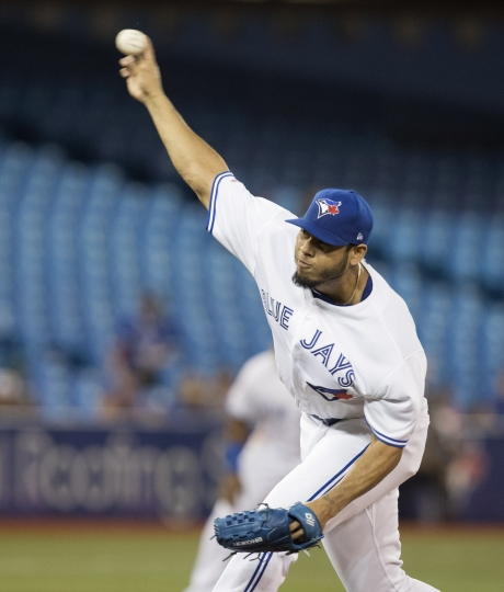 Toronto Blue Jays starting pitcher Wilmer Font throws to a Boston Red Sox batter during the first inning of a baseball game Wednesday, Sept. 11, 2019, in Toronto. (Fred Thornhill/The Canadian Press via AP)