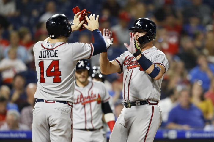 Atlanta Braves' Tyler Flowers, right, and Matt Joyce celebrate Flowers' three-run home run off Philadelphia Phillies starting pitcher Zach Eflin during the fourth inning of a baseball game Wednesday, Sept. 11, 2019, in Philadelphia. (AP Photo/Matt Slocum)