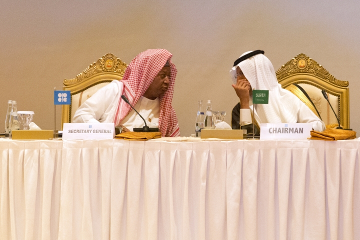 """OPEC Secretary-General Mohammed Barkindo, left, and Saudi Energy Minister Prince Abdulaziz bin Salman, right, confer with each other before an OPEC meeting in Abu Dhabi, United Arab Emirates, Thursday, Sept. 12, 2019. OPEC's Joint Ministerial Monitoring Committee met Thursday in Abu Dhabi as estimates of lowered crude oil demand in 2020 have the cartel considering additional production cuts. Before the meeting started, Prince Abdulaziz again called for """"cohesiveness"""" in OPEC. (AP Photo/Jon Gambrell)"""