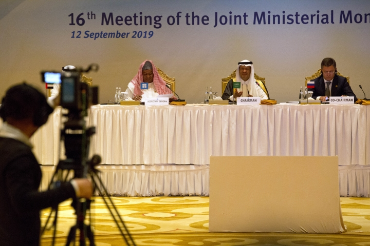 """A cameraman films OPEC Secretary-General Mohammed Barkindo, left, Saudi Energy Minister Prince Abdulaziz bin Salman, center, and Russian Energy Minister Alexander Novak, right, before an OPEC meeting in Abu Dhabi, United Arab Emirates, Thursday, Sept. 12, 2019. OPEC's Joint Ministerial Monitoring Committee met Thursday in Abu Dhabi as estimates of lowered crude oil demand in 2020 have the cartel considering additional production cuts. Before the meeting started, Prince Abdulaziz again called for """"cohesiveness"""" in OPEC. (AP Photo/Jon Gambrell)"""