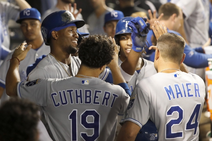 Kansas City Royals' Jorge Soler, left, celebrates in the dugout his two-run home run off Chicago White Sox relief pitcher Carson Fulmer during the eighth inning of a baseball game Wednesday, Sept. 11, 2019, in Chicago. (AP Photo/Charles Rex Arbogast)