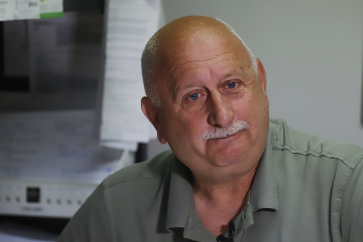 In this Sept. 11, 2019, photo, Barberton police detective Dan Simpson talks about the the loss of his daughter to an opioid overdose while in his office at the department headquarters in Barberton, Ohio. For public officials in Akron and countless other communities across the country, no amount of money will restore the neighborhoods, families and institutions that were upended by prescription painkillers, heroin and fentanyl. (AP Photo/Keith Srakocic)