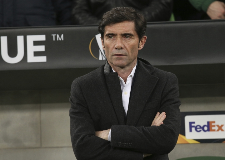 FILE - In this March 14, 2019, file photo Valencia coach Marcelino García Toral watches from the sideline during a Europa League round of 16, second leg soccer match against FC Krasnodar in Krasnodar, Russia. Valencia fired coach Marcelino García Toral on Wednesday, Sept. 11, 2019, three games into the Spanish league season, hiring former Real Madrid and Barcelona player Albert Celades as his replacement. (AP Photo/Vitaliy Timkiv, File)