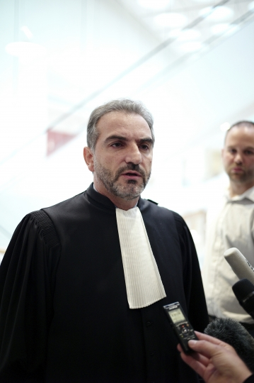 The plumber's lawyer Georges Karouni, speaks to the press at the courthouse, in Paris, Thursday, Sept. 12, 2019. The only daughter of Saudi Arabia's King Salman has been found guilty by a Paris court of charges that she ordered her bodyguard to detain and strike a plumber for taking photos at the Saudi royal family's apartment in the French capital. (AP Photo/Thibault Camus)