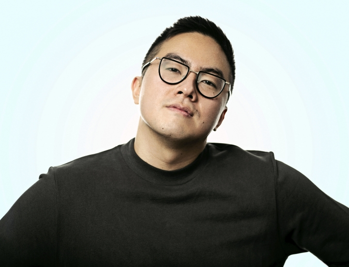 """This undated image released by NBC shows Bowen Yang who, along with Chloe Fineman and Shane Gillis, will join the cast of """"Saturday Night Live,"""" premiering its 45th season on Sept. 28. Yang, who joined NBC's """"SNL"""" last season as a staff writer, is the show's only Asian American performer. He also co-hosts the podcast, """"Las Culturistas."""" (Alex Schaefer/NBC via AP)"""