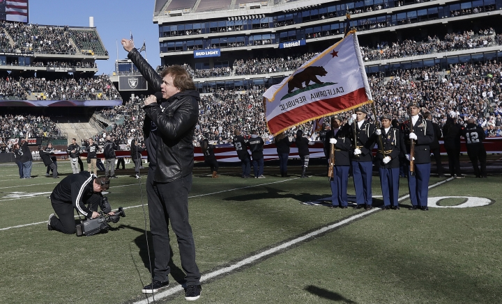 "FILE - In this Dec. 24, 2016 file photo, Eddie Money performs the national anthem before an NFL football game between the Oakland Raiders and the Indianapolis Colts in Oakland, Calif. Money, the husky-voiced, blue collar rock star known for such hits as ""Two Tickets to Paradise"" and ""Take Me Home Tonight,"" has died at age 70 in Los Angeles. Publicist Cindy Ronzoni provided a statement from the family that says he died Friday, Sept. 13, 2019. (AP Photo/Marcio Jose Sanchez)"