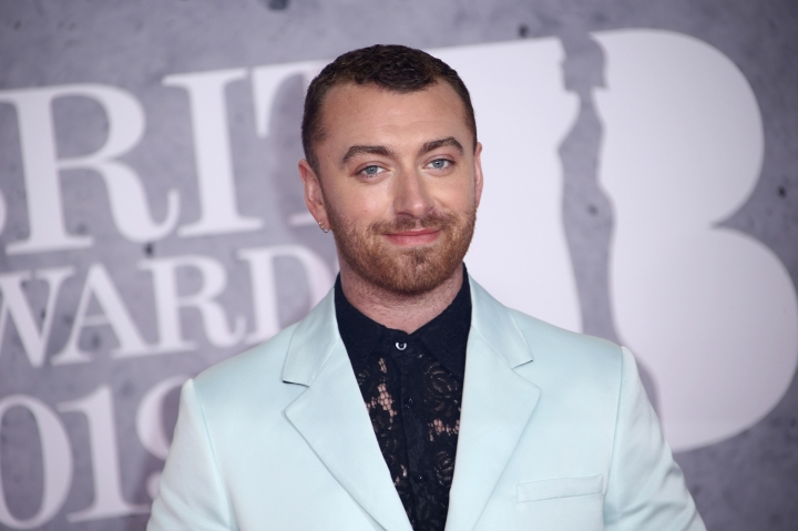 "File-This Feb. 20, 2019, file photo shows singer Sam Smith posing for photographers upon arrival at the Brit Awards in London. The Oscar-winning pop star has declared his pronouns ""they/them"" on social media after coming out as non-binary in his ""lifetime of being at war with my gender."" The English ""Too Good at Goodbyes"" singer said Friday, Sept. 13, 2019, he's decided to ""embrace myself for who I am, inside and out ..."" (Photo by Joel C Ryan/Invision/AP, File)"