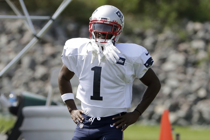 New England Patriots wide receiver Antonio Brown pauses while working out during NFL football practice, Wednesday, Sept. 11, 2019, in Foxborough, Mass. Brown practiced with the team for the first time on Wednesday afternoon, a day after his former trainer filed a civil lawsuit in the Southern District of Florida accusing him of sexually assaulting her on three occasions. (AP Photo/Steven Senne)