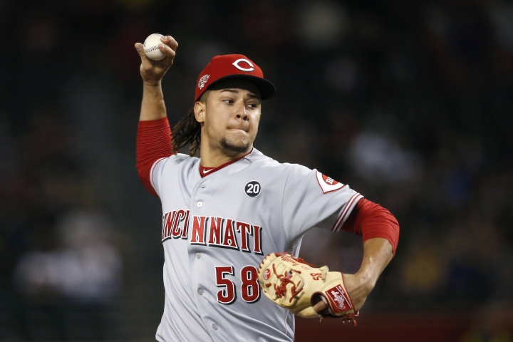 Cincinnati Reds starting pitcher Luis Castillo throws against the Arizona Diamondbacks during the first inning of a baseball game Friday, Sept. 13, 2019, in Phoenix. (AP Photo/Ross D. Franklin)