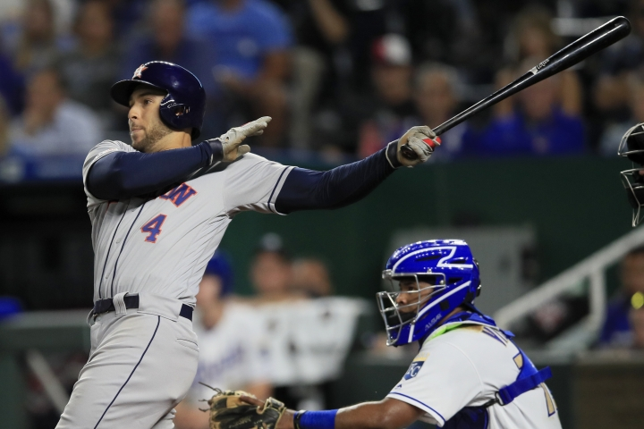 Houston Astros' George Springer watches his three-run home run during the ninth inning of the team's baseball game against the Kansas City Royals at Kauffman Stadium in Kansas City, Mo., Friday, Sept. 13, 2019. The Astros won 4-1. (AP Photo/Orlin Wagner)