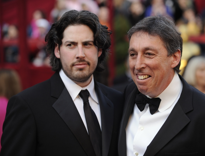 "FILE - In this Feb. 24, 2008 file photo, Jason Reitman, left, an Oscar nominee for best director for his work on ""Juno,"" arrives with his father, director Ivan Reitman for the 80th Academy Awards in Los Angeles. The upcoming ""Ghostbuster"" sequel will focus on the descendants of the original ghost-catchers who rushed around New York City in proton packs and jumpsuits. Ivan Reitman and Dan Aykroyd revealed details of the new film, saying it is expected out next year and will star Paul Rudd, Finn Wolfhard, Carrie Coon and McKenna Grace. Reitman directed the original 1984 film and Aykroyd co-wrote and co-starred in it. Reitman's son, Jason, is directing the new movie. (AP Photo/Chris Pizzello, File)"