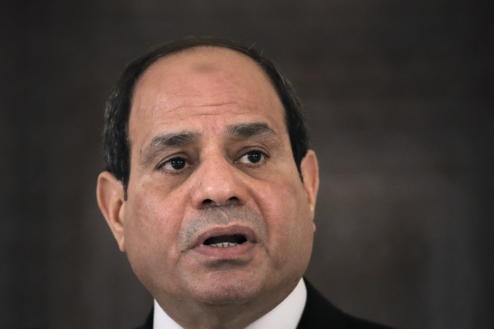 "FILE - In this June 19, 2019 file photo, Egyptian President Abdel Fattah el-Sisi speaks during a press conference in Bucharest, Romania. Abdel-Fattah el-Sissi says Saturday, Sept. 14, that allegations of embezzlement and misuse of public funds in building new presidential palaces are ""sheer lies and defamation."" He says: ""I've built presidential palaces and I will continue to do so. I am building a new country. ... All of this is not mine. It's Egypt's."" (AP Photo/Vadim Ghirda, File)"